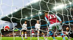 Aston Villa's Jordan Amavi can do little to prevent Adnan Januzaj's shot from finding the net as Manchester United captain Wayne Rooney looks on at Villa Park last night