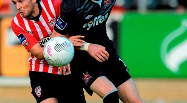 Ciaran Kilduff makes his presence felt against Derry's Barry McNamee at the Brandywell