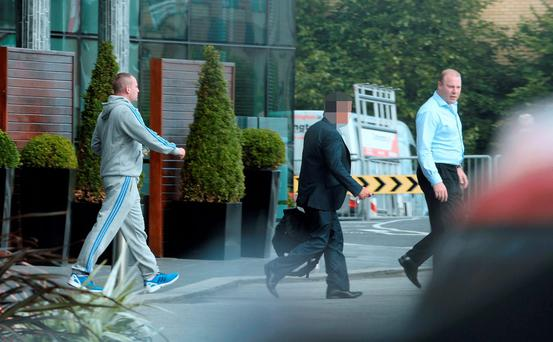 Thomas 'Nicky' McConnell (far left) and Jim Mansfield Jr (far right) leaving the hotel in Blanchardstown