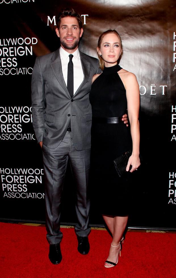 John Krasinski, left, and Emily Blunt arrive at The Hollywood Foreign Press Association's Annual Grants Banquet at the Beverly Wilshire hotel