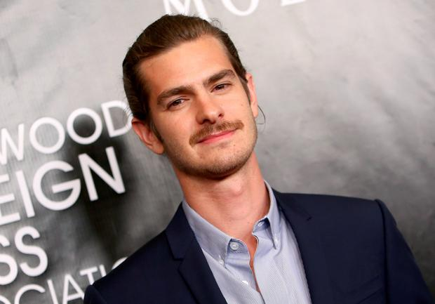 Andrew Garfield arrives at The Hollywood Foreign Press Association's Annual Grants Banquet at the Beverly Wilshire hotel on Thursday, Aug. 13, 2015, in Beverly Hills, Calif. (Photo by John Salangsang/Invision/AP)