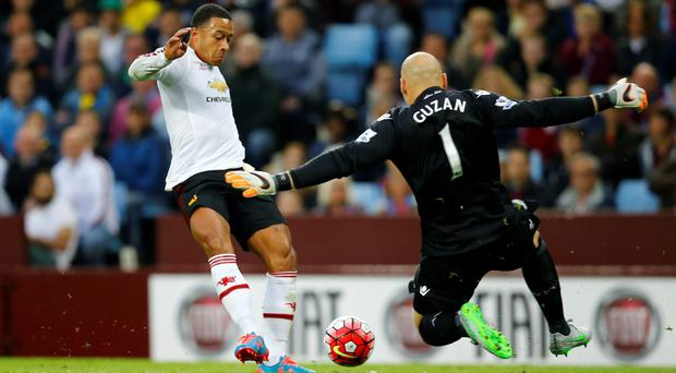 Aston Villa's Brad Guzan in action with Manchester United's Memphis Depay