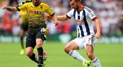 Watford's Miguel Layun (left) and West Bromwich Albion's James Morrison battle for the ball