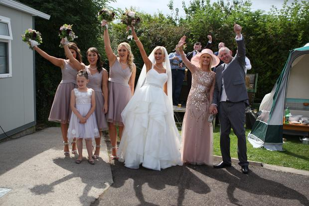 Crystal Swing's Derval Burke at home with her wedding party. Photo: Kevin Mc Nulty