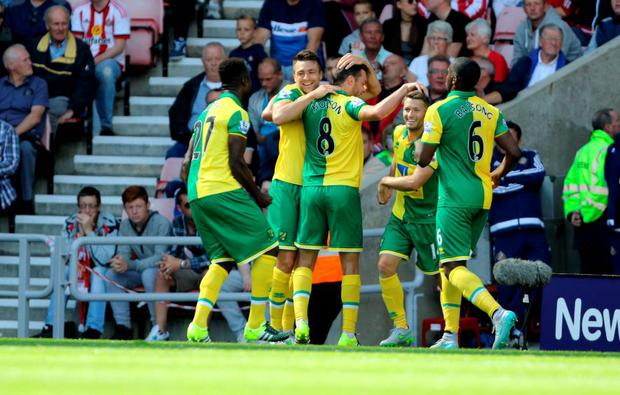 Norwich City's Russell Martin celebrates scoring his side's first goal of the game
