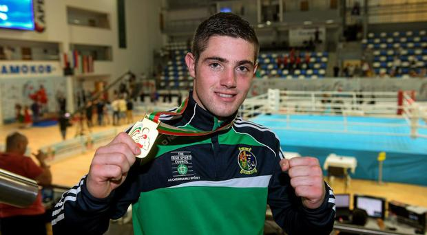 Joe Ward celebrates with his gold medal after victory over Peter Mullenberg, The Netherlands, during their 81kg light heavy weight final bout.