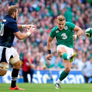 Ian Madigan kicks crossfield to setup Luke Fitzgerald for Ireland's fourth try.