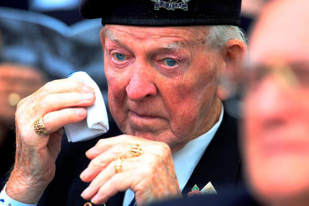 A veteran wipes away a tear, at Horse Guards Parade, London, during the National Commemoration and Drumhead Service, marking the 70th anniversary of VJ Day. Photo: Jonathan Brady/PA Wire