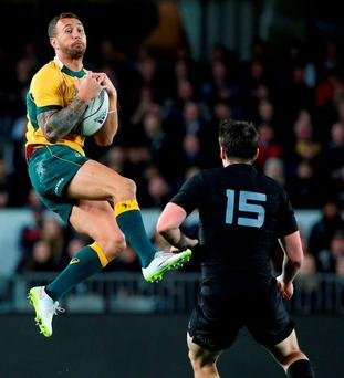 Quade Cooper in action against New Zealand in Auckland yesterday