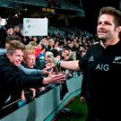 Richie McCaw on a lap of honour after the All Blacks retained the Bledisloe Cup with victory over Australia in Auckland yesterday. Photo: Fiona Goodall