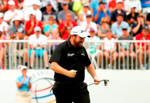 Shane Lowry celebrates after a birdie putt on the 18th green during the final round of the World Golf Championships