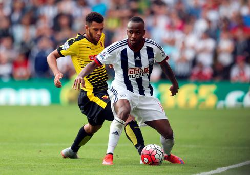 West Brom's Saido Berahino and Watford's Etienne Capoue in action at Vicarage Road yesterday