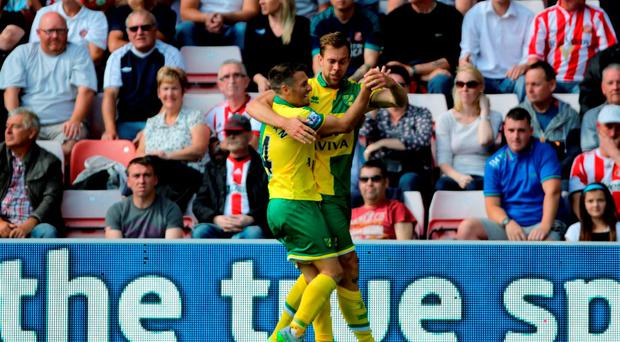Norwich City's Steven Whittaker (right) celebrates scoring his side's second goal of the game with teammate Wes Hoolahan