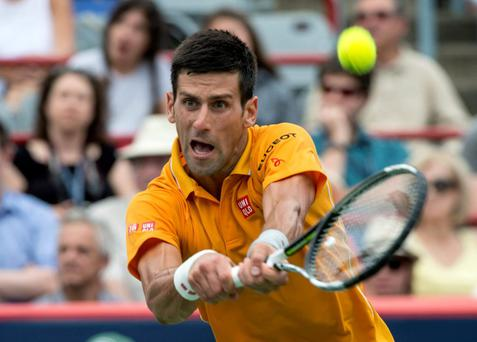 Novak Djokovic returns to Jeremy Chardy during the semifinals at the Rogers Cup tennis tournament