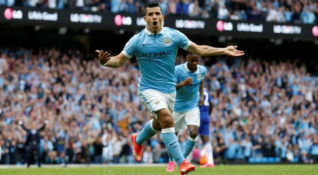 Sergio Aguero celebrates scoring the the first goal for Manchester City