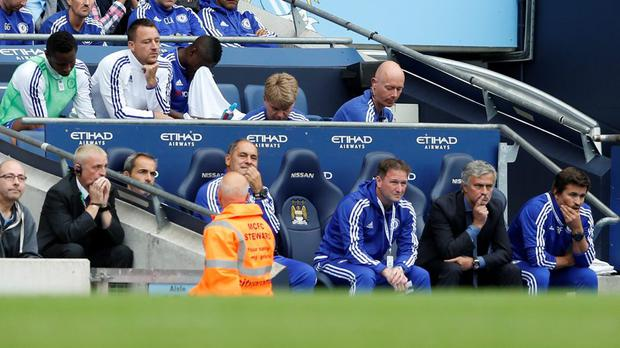 Chelsea's John Terry sat on the bench behind manager Jose Mourinho after being substituted at half time