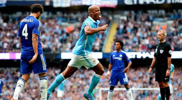 Manchester City's Vincent Kompany celebrates scoring his side's second goal of the game