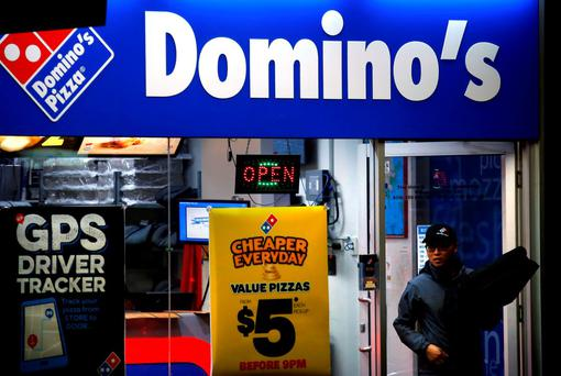 A Domino's store in Sydney advertising its driver-tracking app