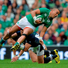 Ireland's Simon Zebo is tackled by Scotland's Richie Vernon at the Aviva Stadium