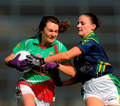 Mayo's Niamh Kelly battles for the ball with Gina Crowley