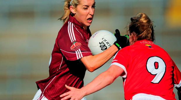 Galway's Marie Hoey charges through Brige Corkery of Cork