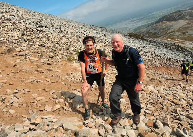 Mickey Lynch, from Camlough, Armagh, and Joe Reilly from Virgina, Co Cavan, climbing Croagh Patrick. Photo: Conor McKeown