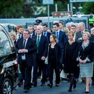 Mourners including Justice Minister Frances Fitzgerald (right) at the funeral of her mother Anna Ryan at St Conleth's church, Newbridge, Co Kildare, yesterday.