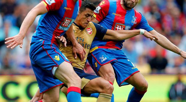 Alexis Sanchez battles it out with Crystal Palace pair Scott Dann and Yohan Cabaye at Selhurst Park
