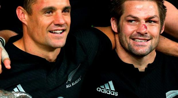 Dan Carter and Richie McCaw – who eclipsed Brian O'Driscoll as the most-capped player in Test history with 142 appearances – celebrate their Bledisloe Cup victory at Eden Park on Saturday