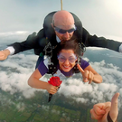 Rose of Tralee Maria Walsh holds a rose as she skydives with Carl Carey of Tandem Skydive Club