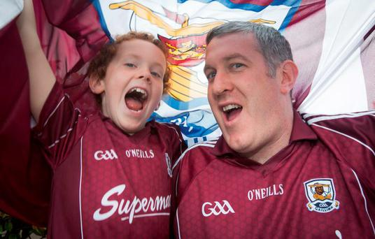 Galway fans Enda Murphy (8) and his father Paul, from Athenry, at Croke Park yesterday