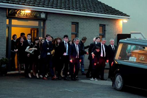 Mourners, led by Conor, Billy and John Keane, at the removal of Mary Keane in Listowel, Co Kerry, yesterday