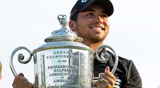 Jason Day, of Australia, smiles as he holds up the Wanamaker Trophy after winning the PGA Championship golf tournament