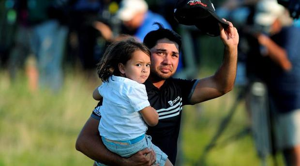 Jason Day walks off the 18th green with his son Dash Day after winning the 2015 PGA Championship golf tournament at Whistling Straits. Credit: Thomas J. Russo-USA TODAY Sports