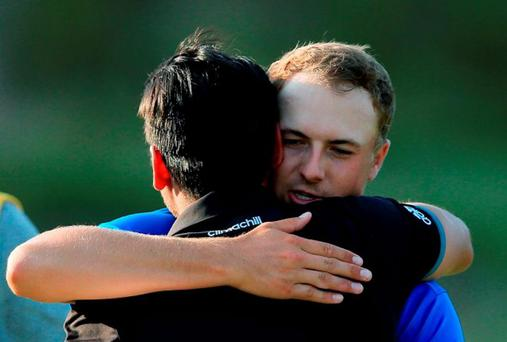 Jordan Spieth of the United States greets Jason Day of Australia after Day's three-stroke victory at the 2015 PGA Championship at Whistling Straits. Photo by David Cannon/Getty Images)