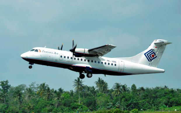 In this photo taken Dec. 26, 2010, Trigana Air Service's ATR42-300 twin turboprop plane takes off at Supadio airport in Pontianak, West Kalimantan, Indonesia. The same type of a Trigana airliner carrying 54 people was missing Sunday, Aug. 16, 2015 after losing contact with ground control during a short flight in bad weather in the country's mountainous easternmost province of Papua, officials said. A search for the plane was suspended and will resume Monday morning. (AP Photo)