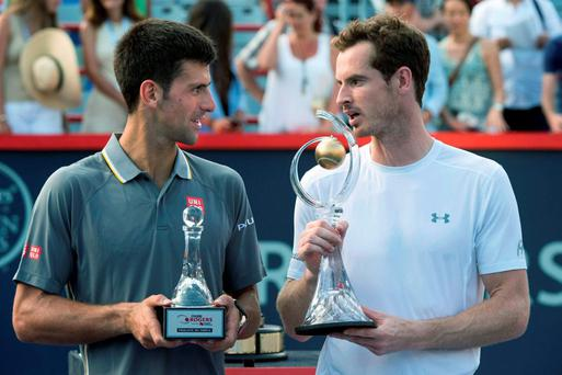 Tournament winner Andy Murray, right, of Scotland, chats with his opponent Novak Djokovic, of Serbia, during ceremonies following the men's final at the Rogers Cup tennis tournament in Montreal