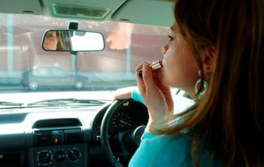 Applying make-up behind the wheel is a dangerous road habit.