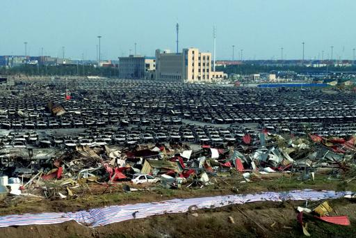 Charred remains of new cars are seen in a parking lot near the site of the chemical explosion at a warehouse in northeastern China's Tianjin