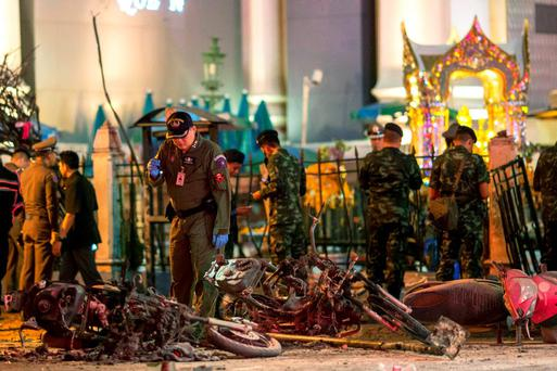 Experts investigate at the site of a blast in central Bangkok August 17, 2015. REUTERS/Athit Perawongmetha