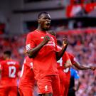 Liverpool's Christian Benteke celebrates scoring his first goal for the club against Bournemouth