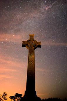 Photographer Kieran Hayes made the most of the clear skies as he captured the moment a meteor flashed across the sky above the High Cross at Long Strand, west Cork