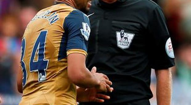 Referee Lee Mason was widely criticised for failing to send off the Arsenal midfielder Francis Coquelin
