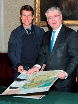 Then-Tanaiste Eamon Gilmore presents Tom Cruise with his Certificate of Irish Heritage in 2013
