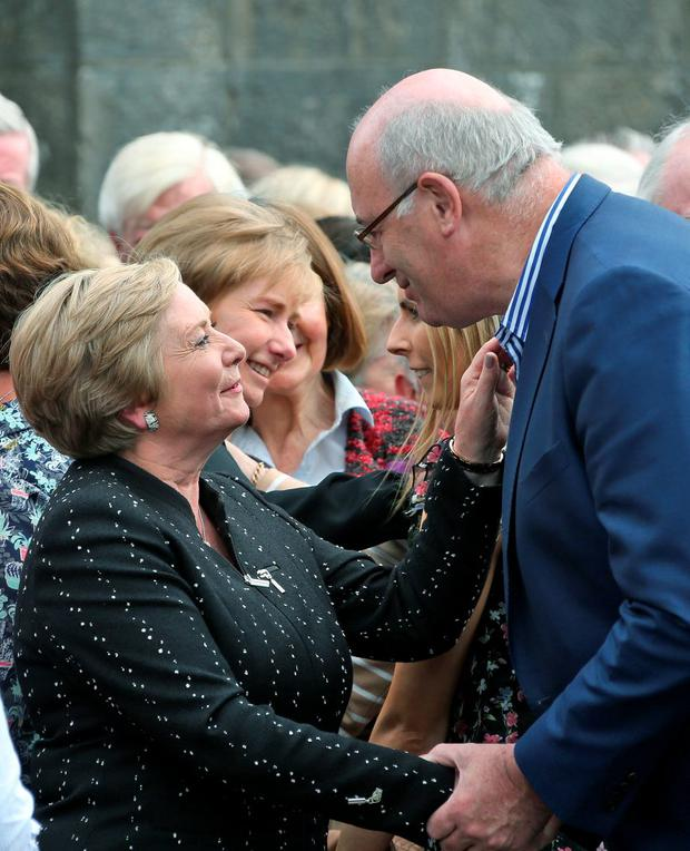 Phil Hogan consoles Justice Minister Frances Fitzgerald at the funeral of her mother, Anna Ryan at St Conleth's Church, Newbridge, Co Kildare.