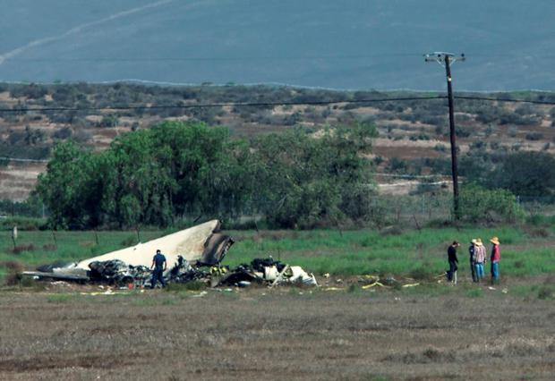 Authorities investigate the crash site where a twin-engine Sabreliner collided with a single-engine Cessna 172 as both were on approach to land at Brown Field, in Otay Mesa, California August 17, 2015. REUTERS/Mike Blake