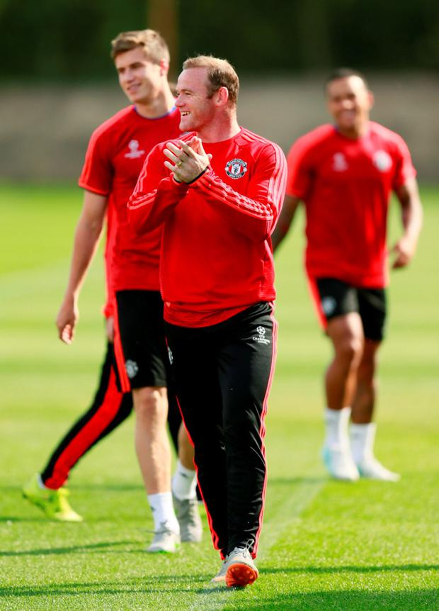 Wayne Rooney is pictured in training ahead of tonight's Champions League play-off first leg tie with Club Brugge