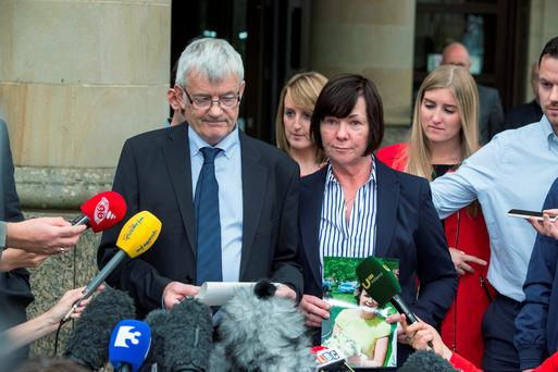 John Buckley gives a statement with his wife Marian at the HIgh Court of Justiciary, Glasgow after Alexander Pacteau admitted to murdering their daughter Karen