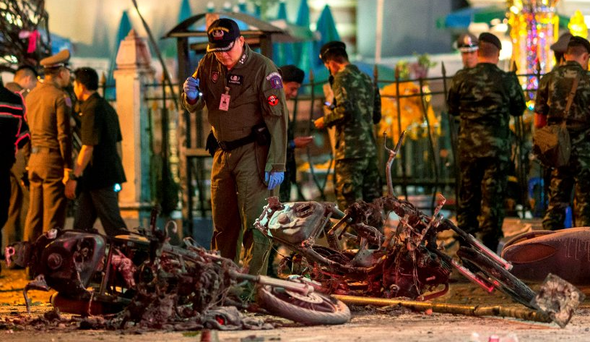 Paramedics and security forces at the scene of blast near the Erawan Shrine in Bangkok that left at least 18 people dead yesterday
