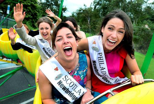 Rose of Tralee contestants Bríd Madigan (Scotland) and Mairéad Comaskey (Philadelphia) enjoy an outing at Bird's Amusements in Tralee, Co Kerry. In the background is Queensland Rose Niamh Healy. Photo: Steve Humphreys